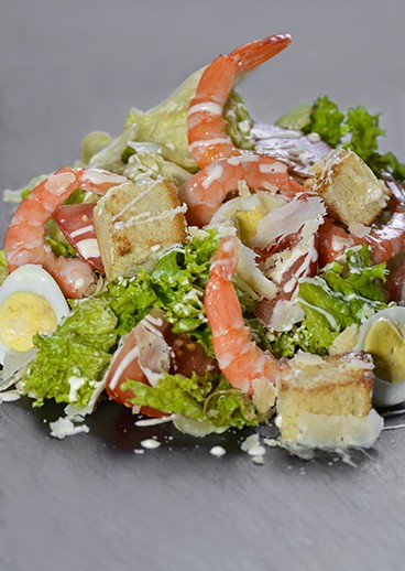 Caesar salad with shrimps  in Kharkov  - photo